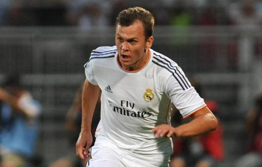 Rescue workers stand near the Christmas market in Berlin